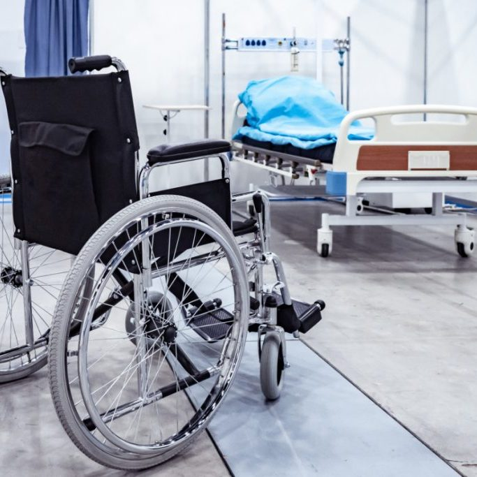 Wheelchair. Medical bed. Disease resulting in disability. Hospital. Hospital bed on wheels. Disease. Medical service. Disability.